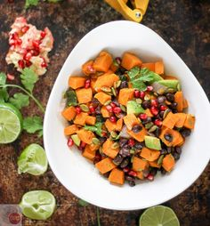 This Sweet Potato Salad with a Southwest Vinaigrette is one of our favorites for summer. The combination of sweet potatoes, black beans, crunchy pumpkin seeds, and juicy pomegranate seeds makes a wonderful side dish recipe for potlucks or even dinner. It would make a great vegetarian lunch too!