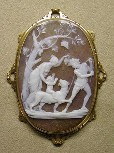 Education of the infant Bacchus (Cameo)  Niccolò Amastini (1780–1851)  Date: first half 19th century  Culture: Italian (Rome)  Medium: Onyx, gold frame  Dimensions: Visible cameo, overall: 2 1/16 x 1 7/16 in. (5.2 x 3.6 cm), 52.3 x 36.3 mm Overall (in setting): 2 9/16 x 1 7/8 in. (6.5 x 4.8 cm)  Classification: Lapidary Work  Credit Line: The Milton Weil Collection, 1940  Accession Number: 40.20.30   Metropolitan Museum of Art