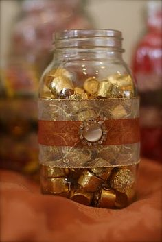 Mason jars wrapped in ribbons and blingies used as decoration.  Great gift idea.