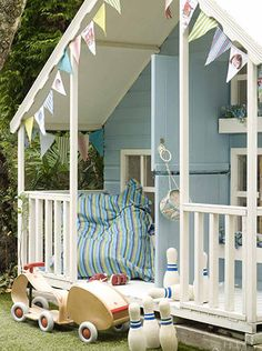 Lovely shed/ garden playhouse. Love the bunting on the little house.