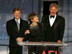 HOLLYWOOD - JUNE 09:  (L-R) Actors Mark Hamill, Carrie Fisher and Harrison Ford speak onstage during the 33rd AFI Life Achievement Award tribute to George Lucas at the Kodak Theatre on June 9, 2005 in Hollywood, California.  (Photo by Kevin Winter/Getty Images) via @AOL_Lifestyle Read more: http://www.aol.com/article/entertainment/2016/12/27/actress-carrie-fisher-dead-at-60/21642781/?a_dgi=aolshare_pinterest#fullscreen