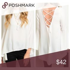 🔥COMING SOON!🔥 White Bell Sleeve Blouse COMING SOON!! White long sleeve top featuring trim at sleeves & hem, slight bell sleeve, and laced tie back detail. 100% Polyester. Available in S,M,L. Pre-order now! Tops Blouses