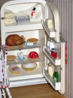 Christmas Kitchen: The refrigerator is a Hallmark Christmas ornament.