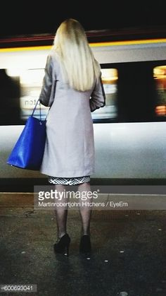 Foto stock : Rear View Of Woman Standing On Railroad Station Platform Against Train