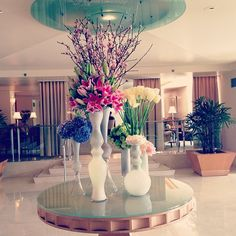 An eclectic mix of colors, flowers and vases inside L'Ermitage Beverly Hills.