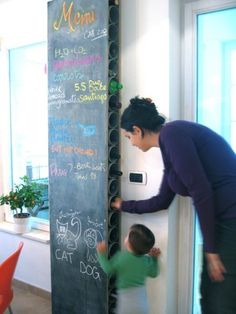 DIY chalkboard wine rack made with PVC and fiberboard. Two sections of board, cut pvc pipe sandwiched in the middle, chalkboard paint. Pvc Pipe Projects, Home Projects, Craft Projects, Chalkboard Paint, Kitchen Chalkboard, Chalkboard Fabric, Wine Storage, Storage Ideas, Organization Ideas