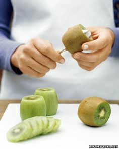 Easiest way to skin a Kiwi... Trim both ends then run a spoon between the peel and the flesh pressing the back of the spoon against the peel. The whole fruit slides out ready for slicing