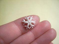 Mini-origami! A beautiful snowflake.