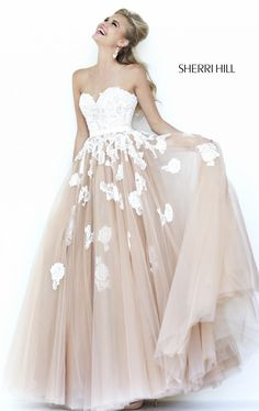 I would wear this as my wedding dress if the bottom was a lighter peachy pink.