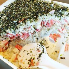 Crack Sushi?  Sushi Casserole?  Similar to this but only one layer of rice and add chopped cucumbers and avocado to the top.