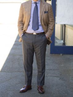 Beige jacket, light blue shirt, blue tie, light grey pants