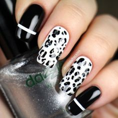 black white and silver animal print nails with glitter by nailsbyfreckles from instagram