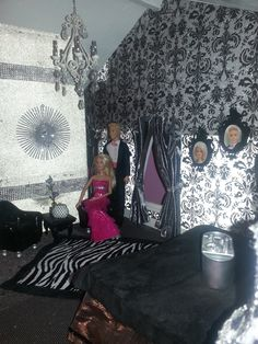 Custom Barbie House!  This master bedroom suite features a sitting area with a zebra rug and silver chandelier! Black and silver damask scrapbook paper makes for gorgeous walls.