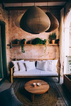 Browse Free HD Images of Bohemian-Style Balcony With White Bamboo Sofa Coffee Table Books, Round Coffee Table, Bamboo Sofa, Living Spaces, Living Room, Small Living, Rustic Outdoor, Rustic Wood, Upholstered Sofa