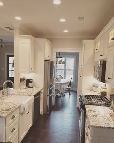 Convert kitchen to large galley style, partially open to dining room, refinish cabs
