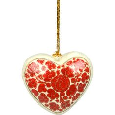 Allow your heart to bloom with love for this holiday ornament handcrafted in papier mâché and painted with a ruby-coloured floral pattern. From the makers of artisan group Asha, which works to ensure that benefits of handicraft production reach the workers themselves.