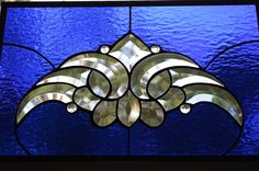 """Stunning Cobalt Stained Glass Panel, Jewels and Beveled Cluster, Metal Frame..Custom Made..Perfect 16 1/2""""W x 10 1/2"""" H. This beautiful Cobalt Blue Textured Stained Glass panel is breathtaking. Adorned with crystal jewels and a beautiful bevel cluster; truly lovely in the sunlight and a perfect size to hang in your favorite window. Dark solder and Metal framed for additional strength. Custom made just for you. It will add privacy, elegance and great art to your home. If you plan to hang…"""