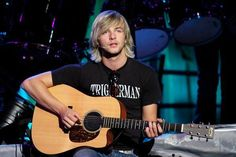 Keith Harkin is amazing for the following reasons: 1. he's got a hot Irsish accent 2. he sings (nothing's hotter than a guy with a great voice) 3. he surfs 4. he plays the guitar 5. he is a great song writer