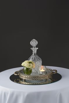 Crystal decanter centerpiece with white floral #crystal centerpiece #vintage centerpiece #wedding centerpiece   www.decorit.com.au