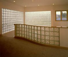 Glass blocks used as a banister for a an upper floor, half wall