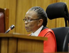 Judge Thokozile Masipa reads her verdict as Oscar Pistorius (unseen) sits in the dock during his mur. Oscar Pistorius, The Verdict, Uk News, Trials, Black History, Thoughts, Photo And Video, This Or That Questions, Face