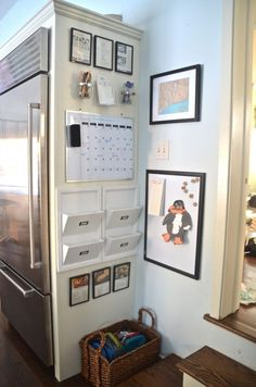Charlotte from Ciburbanity transformed her small refrigerator side-wall cabinet into a multitasking kitchen command center inexpensively with a dry-erase board and calendar, mason jar writing-utensil holders, mail-sorting pockets, and a catchall basket for lunch boxes.
