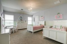 Adorable pink, white and green girl's room, love the white furniture and the chair rail separating wall colors