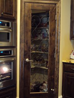 great pantry door. iron work added to standard french door. would look better with frosted glass i think.