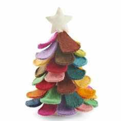 "Arcadiahomeinc.com scallop tree. $79 This pretty standing felt tree includes all the colors of the rainbow. Topped with a simple white star. Makes a lovely holiday table centerpiece, or mantle decor. Hand stitched, hand felted, in 100% sustainable wool. 13""x9""."