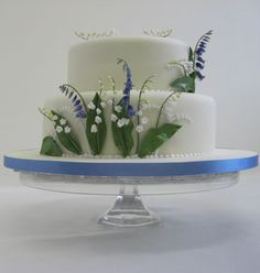 A bluebell design, although we'd have to do this with artificial bluebells - sugarpaste stood up in this way wouldn't survive the journey!