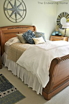 Nautical compass above bed.