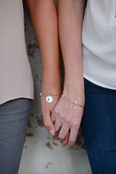 These handmade Sterling Mother & Daughter Bangle Bracelets represent the bond of love between mothers and daughters. Handmade of sterling silver.