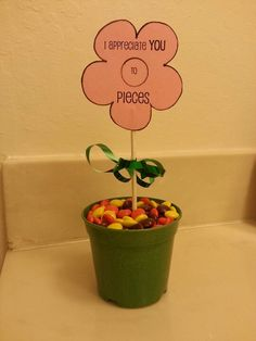 """An easy and cheap gift to make for someone you love and/appreciate.  I used a mini plastic flower pot filled with reese's pieces.   Found a cute flower template to make my """"card"""" and taped it onto a lollipop stick.  Tied a green gift wrap ribbon to act as the """"leaves"""".  And voila.  Your recipient will ♥ it!"""