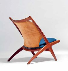 The Krysset lounge chair by Fredrik Kayser in collaboration with Adolf Rellling, 1955. Manufactured by Gustav Bahus, Norway