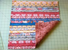 You asked for the tutorial so here it is! For this project I used jelly roll strips. You can make a total of four 16×16 inch pillows using one jelly roll – my tutorial below shows you ho…