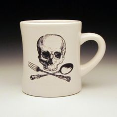 Aargh, matey! Drink up!A chef's take on a skull and crossbones design with a fork and spoon in place of bones... Skull and cross-cutlery? This is a SET of TWO bright white restaurant style ceramic diner mug that has been refired with a screen-printed overglaze skull and crossbones decal that is now fused onto the surface. The decal image is black.Holds 10 ozMeasurement: 4