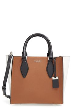 Richly textured calfskin leather defines this sophisticated, versatile Michael Kors satchel featuring handsome contrast trim, an optional crossbody strap and silvertone hardware detailing.