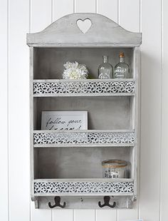 Parisian wall shelf with three shelves, two hooks and ornate front
