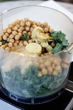 1 bulb of fresh garlic    1 large can (25 ounces) organic garbanzo beans (chickpeas)    1/3 cup fresh lemon juice    1/4 cup tahini, well stirred    1 1/4 teaspoons coarse or kosher salt    1 small bunch kale, stems removed and roughly chopped, about 2 to 3 tightly packed cups    1-2 tablespoons olive oil    Red pepper flakes or black pepper