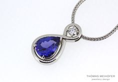 Lovely Tanzanite and diamond pendant set into platinum… What better way to show the one you love just how much you love them than with an eternity symbol wrapped around a tanzanite and diamond? This is one very lucky lady. Pendant Set, Diamond Pendant, Eternity Symbol, Lucky Ladies, Pearl Jewelry, Sapphire, Jewelry Design, Jewellery, Pearls