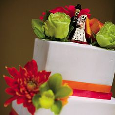 """Brides: Wedding Cake with Unique Mexican Topper. A friend bought this unique Mexican cake topper (called """"Los Muertos"""") for Victoria as a shower gift; """"It%u2019s a traditional symbol of a couple being together forever,"""" the bride explains, """"even after death."""""""