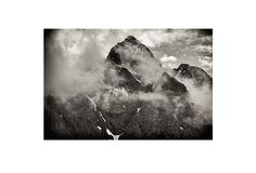 """I looked up, and the clouds parted. Shards of rock split the sky. Huge slabs of granite fell towards the sea. I imagined Thor, atop the peak, surveying all below.""        Original Photo Art offers high quality, limited-edition, signed photographic prints that will make you the envy of your friends."