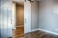 Ever thought about trying sliding barn doors to an entryway? // Design by 303 Development Entry Way Design, Barn Doors, Custom Homes, Denver, Tall Cabinet Storage, Entryway, King, Furniture, Home Decor