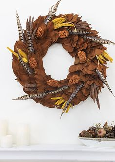 Copper Feather: Magnolia leaves are cut off the farm from specimen magnolia trees and hand-crafted into a beautiful dried magnolia wreath. This magnolia form is the base for this stunning fall wreath. Copper toned magnolia leaves serve as the backdrop against all natural pheasant feathers with fall colored grasses and natural seed pods.   · Cut fresh from the farm daily   · Made by hand in the USA    · Beautiful packaging