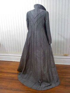 Here is a Thranduil coat that I made a few years ago.  It has bias piping in the seams but without the dimensional cording so the accent color lies flat but you still get the definition of the seam design.