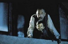 Toto and Alfredo are watching the film on the building wall, Cinema Paradiso.