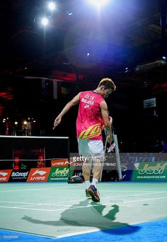 Malaysia's Lee Chong Wei watches the shuttlecock go out as he competes against Denmark's Axelsen during the men's single semi final match at the 2014 BWF Badminton World championships held at the Ballerup Super Arena in Copenhagen on August 30, 2014. Lee Chong Wei won the match 42 - 16.