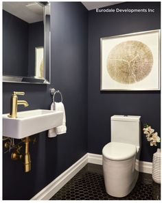 Love this dark blue for a bathroom. Especially with gold accents