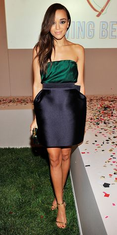 Ashley Madekwe stunned at The Foundation for Living Beauty's third annual fashion fundraiser in a Lanvin ensemble, pairing an emerald strapless top with a navy skirt, and topping it all off with a green minaudiere and gold metallic sandals.