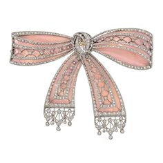 Belle Époque Diamond Pink Enamel  Bow Brooch | See more rare vintage Brooches at https://www.1stdibs.com/jewelry/brooches/brooches